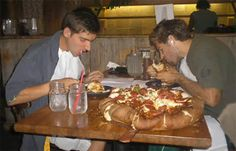 Beau Jo's Pizza Challenge - Grand Sicilian Pizza made of 12 to 14 pounds of hamburger and sausage on a loaded 16-inch thick crust pizza. You and a friend will have one hour to complete the challenge. If successful, the pizza is free and you'll receive $100 and two free T-shirts.