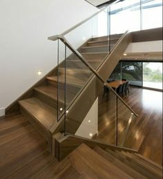 An elegant stair, Mathoura Road brings modern glass balustrade together with stainless steel handrail. Modern Stair Railing, Staircase Handrail, Stair Railing Design, Wooden Staircases, Modern Stairs, Handrail Ideas, Banisters, Timber Staircase, Spiral Staircases