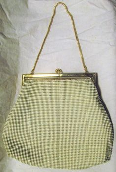 Vintage Whiting And Davis Handbag Vintage White Mesh Purse Gold Metal Frame Kiss Clasp Wedding Purse Bridal 1970s 70s    vintage Whiting & Davis evening bag.  sparkly metallic gold and white mesh.  gold tone kiss clasp and square metal frame.  blush satin interior with a pocket.  stamped with the whiting and davis logo on the metal frame along with parts number 2983, made in the usa.  inside and out is very clean. not a single stain.  short gold snake chain handle.  there are 2 missing mesh…