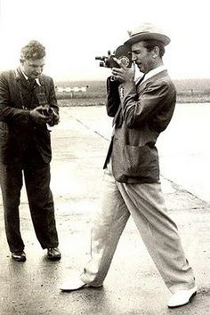 A young Walt Disney with his home movie camera.