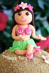 Hula Girl Topper via The Sugar Fairy.  Can be made into a mermaid and used on top of a central cupcake!