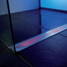 linear drain. The idea is to drain as much water as possible if you have a doorless shower.