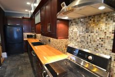 Another Steve Bremis Team Exclusive... Winterhill, Somerville MA.  Great custom kitchen, butcher block counter top with glass tile back splash.  In Our Travels with Steve & Brenda Bremis