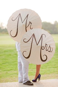 Much cuter (and re-usable) than Just Married --- wonder if we could DIY this in a permanent marker? MR and MRS umbrellas