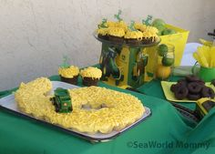 For our John Deere party I made yellow cupcakes (minis) into the number 6 with icing hay and a combine. The chocolate (large) cupcakes have John Deere deer logos made from Candy Melts I traced onto parchment paper. We also had green apples, yellow rock candy and tractor wheels (aka donuts) .