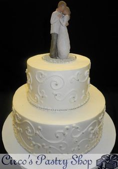 New York Wedding Films likes: Ivory Wedding Cake Tier Ivory Cream Cake with Scroll work and Wedding Ornament