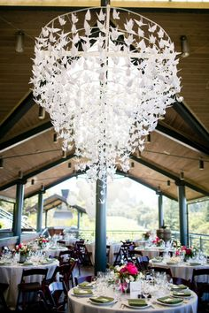 What a stunning origami crane chandelier! Photo by: Larissa Cleveland Photography
