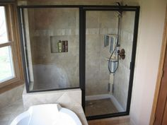 Bathrooms. Designer Shower Enclosures for Modern Bathroom Design. Interior Modern Bathroom Design Feature Two Glass Screen Panel Divider Room With Black Frame Swing Glass Door And Stainless Steel Hand Shower Rain Maker And Drop In Squared Wall Soap Space