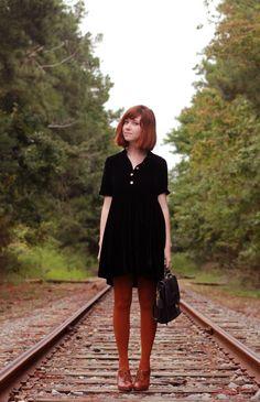 Black velvet, rusty red, Oxford heels.