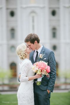 Kissing in front of the Salt Lake City Temple after wedding.