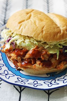 Saucy slow-cooked BBQ chicken sandwiches with an incredible crunchy savory slaw - the perfect main dish for your next summer barbecue!