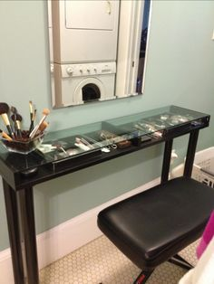 DIY Makeup Vanity From IKEA Parts- For the project you'll need four Vika Curry legs, an Ekby Gruvan shelf, a Kolja mirror, a stool, and acrylic bead storage containers. These things are more than enough to organize a perfect makeup storage. The total cost is only $45. All parts are available in white as well.