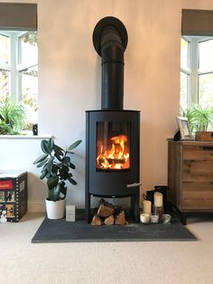 5 Best Decor Ideas for Your Fireplace – Voyage Afield Wood Burner Fireplace, Home Fireplace, Fireplace Design, Wood Burner Stove, Contemporary Wood Burning Stoves, Modern Stoves, Corner Wood Stove, Corner Log Burner, Wood Stove Wall