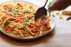 NYT cooking: spaghetti with fresh tomato and basil sauce.
