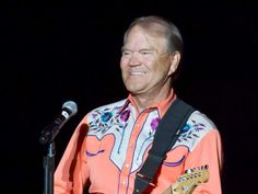 """FILE - This Sept. 6, 2012 file photo shows singer Glen Campbell performing during his Goodbye Tour in Little Rock, Ark. Campbell is releasing his final studio album, which was recorded shortly after his Alzheimer's disease diagnosis in 2011. The record label, Universal Music Enterprises, announced Friday, April 14, 2017, that the album, """"Adios,"""" will be released on June 9. (AP Photo/Danny Johnston, file)"""