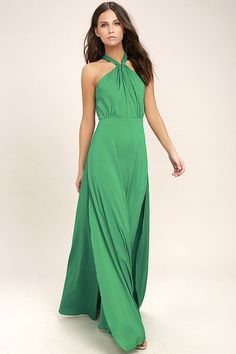 Dreams do come true in the Ever After Green Maxi Dress! Woven poly forms a halter bodice with a front keyhole, button closures behind the neck, and adjustable spaghetti straps atop an open back. Maxi skirt with twin side slits cascades from a fitted waistline for an elegant finale. Hidden back zipper with clasp.