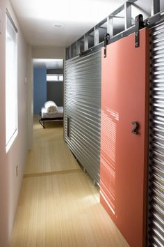 corrugated metal wall with sliding door