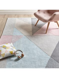 Ideal Home Triangle Geo Rug in 3 size options An abstract geometric design gives this Ideal Home rug an astonishing look that revels in Scandi-charm. In soft pastel tones, triangles of all different sizes overlap one another in organised chaos, making this rug the perfect way to add some personality to your floors. Crafted from polypropylene yarn, it features a soft cotton backing and is hand-finished to give it a real feeling of quality that your feet will love sinking into. This rug is…