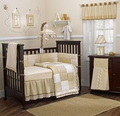 Interior. black wooden crib with white cream bedding set placed on the brown wooden flooring with cream rug in the cream wall room, Beautiful Baby Girl Bedding Ideas Give Attracting Design For Your Daughter Bedroom