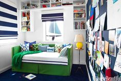 House Beautiful - boy's rooms - navy accent wall, navy blue accent wall, wall bulletin board, full wall bulletin board, built in cubbies, su...
