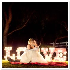 Over-sized lit letters for a nighttime portrait session