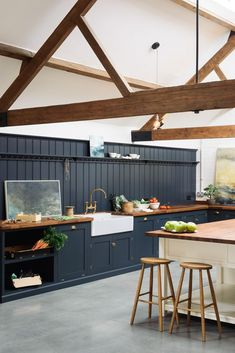 From deVOL Kitchens, a modern farmhouse style kitchen with navy cabinets, tall slanted ceilings and exposed wood beams. Navy is the perfect paint color for a modern farmhouse! Devol Shaker Kitchen, Devol Kitchens, Modern Shaker Kitchen, Dark Kitchens, New Kitchen, Kitchen Decor, Kitchen Island, Kitchen Cabinets, Shaker Cabinets