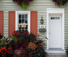 With a colorful home and bright shutters, a simple white door is a classic choice. More ways to add character: http://www.bhg.com/home-improvement/remodeling/budget-remodels/easy-ways-to-add-character/?socsrc=bhgpin072712redshutterswhitedoor