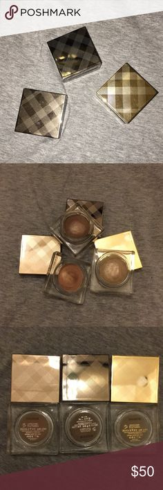 Burberry cream eyeshadow Cream shadows. Lightly tested so the the cream on top is a little rubbed, I just wanted to test on my skin. Otherwise, very clean and useable.   Festive gold No.120 Mink No.102 Gold Copper No.100  Don't forget to bundle ❤️ Home 🚫smoke free 🚫 pet free Burberry Makeup Eyeshadow