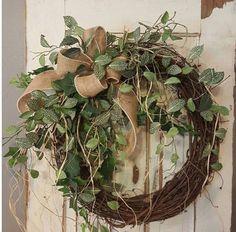 Handmade item  Materials: grapevine wreath, glue, wire, wired burlap, realistic fern, realistic greenery.