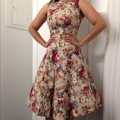California bloom Adorable vintage inspired dress! This dress is made of a stretchy cotton material which gives this a little room for stretch so it's breathable and comfortable! Features a great zip up the back and tie in the back for a more form fitting look. Measures: 34-36 bust and 28 waist and 40 length Dresses Midi