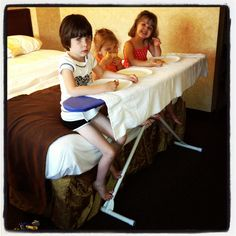 Traveling with kids | Eating in a hotel room. If yours happens to have an ironing board, you're in luck!