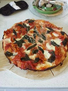 Stove top pizza made in the saute pan in 20 min. Fast, easy and delicious.