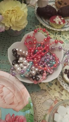 Pearl necklaces in small bowls tea party birthday
