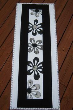 Black and white quilted table runner.