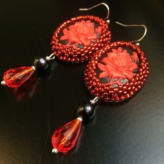 BW48 - beaded earrings with a red rose cameo, back freshwater pearl and a faceted red teardrop