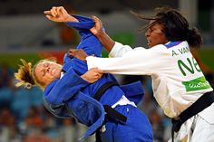 Anicka van Emden of the Netherlands, right, fights against Alice Schlesinger during women's judo 63kg round 16 in the Rio 2016 Summer Olympic Games at Carioca Arena 2.