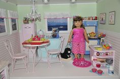 American Girl Dollhouse Kitchen.  I especially love that the sink is a mini version of the play sink I made her!