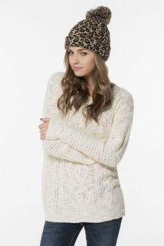 If the cream cable knit sweater doesn't fit, you can always go for the leopard tuque :)