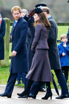 The Duchess attended a post-Christmas service at St. Mary Magdalene Church in a sophisticated, tweed suit by Michael Kors, adding a royal blue hat and gloves to complete the look.