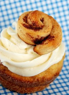 Cinnamon Roll Cupcakes with Cheesecake Frosting topped with Mini Cinnamon Rolls.