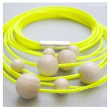 Necklace EARLY ORBIT #1 by www.matterdesign.de in neon-yellow with wooden beads and magnetic clasp, total length 58 cm