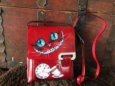 Red leather bag with hand painted Cheshire Cat art, sister gift, cross body purse, shoulder cute coin purse, iPhone wallet case tablet pouch Painted Bags, Painted Clothes, Hand Painted, Cute Coin Purse, Small Coin Purse, Leather Bags Handmade, Handmade Bags, Handmade Bracelets, Black Leather Bags