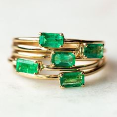 A stunning emerald cut emerald is prong set on a solid yellow gold band A perfect solitaire emerald ring for May born beauties and beyond Shop it now at Emerald Ring Gold, Emerald Jewelry, Diamond Jewelry, Jewelry Rings, Emerald Stone, Diamond Earrings, Silver Ring, Platinum Earrings, Emerald Cut Rings