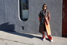 Osman robe, M.i.h Jeans striped top, Etro pants, Golden Goose Deluxe Brand sneakers, Marte Frisnes and Isabel Marant cuffs