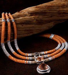 """Necklace SOLAR. Белое золото, оранжевый турмалин огранки """"подушка"""" весом 21,13 карата, рутиловый кварц в форме кабошона, оранжевый гранат (бусины), коричневые бриллианты (бусины), обсидиан, бриллианты."""