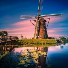 Experience the traditional #windmills of #holland found in Zaanse Schans, a 20 minute drive from #amsterdam  Photographer Remo Scarfo describes it as a 'fairytale land'  #hiddentreasures #holland #zaanseschans #reflection #dutch #culture #europe #travel #travelinspiration