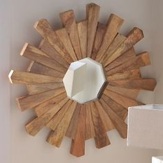 "Nate Berkus™ mirror is made from mango wood and is 36"" in diameter. Made in India."