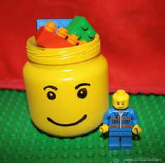 Lego head made from a baby food jar... could be a treat holder for favors