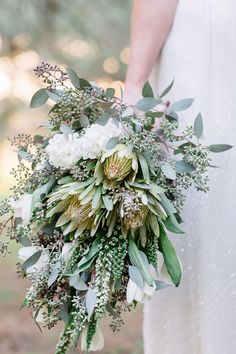 Cream and White Protea Wedding Bouquet. Inspiration and ideas for wedding and bridal flowers. Proteas are a great flower to include in your bridal bouquet and centerpieces. Modern Wedding Flowers, White Wedding Bouquets, Bridal Flowers, Flower Bouquet Wedding, Floral Wedding, Flower Bouquets, Green Bouquets, Green Wedding, Protea Wedding
