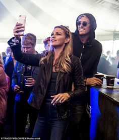 Abbey Clancy watches her brother's band play Leeds Festival